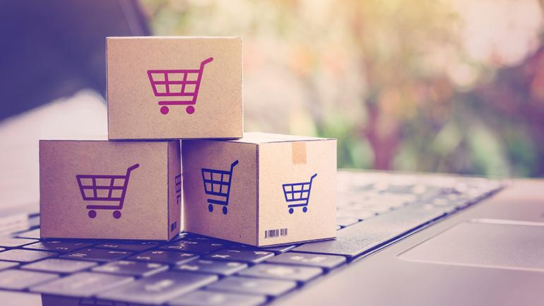 B2B eCommerce - Mini shopping boxes stacked on a keyboard